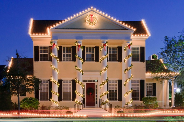 A two story house with Christmas lights
